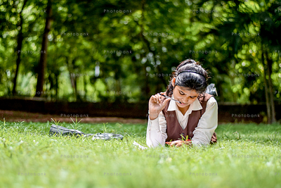 girl with book in park