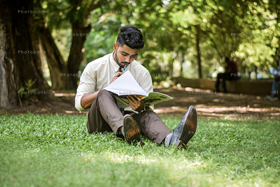boy with book in park