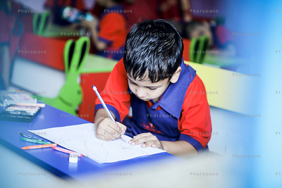 small kid writing in class