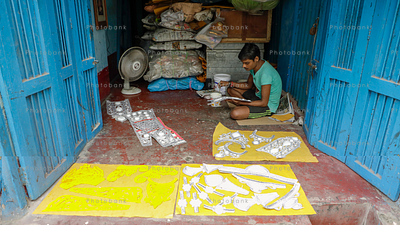 Young artist prepares idols of Goddess Durga ahead of Durga Puja festival