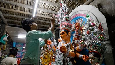 Artist decorating Goddess Durga