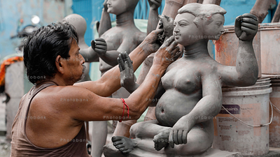 Artist making statue