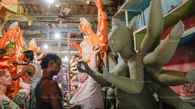 Artist painting goddess Durga