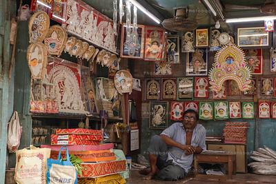 Artist selling posters of goddess Durga