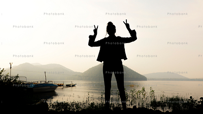 Silhouette of a woman celebrating