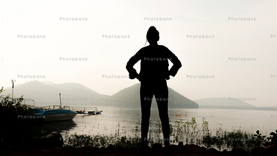Silhouette of a woman standing alone