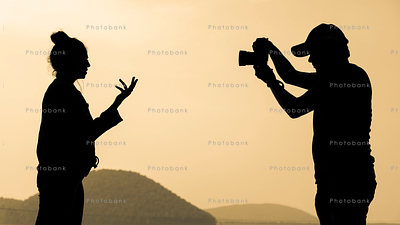 Silhouette of a photographer and model