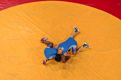 Aerial shot of two wrestler wrestling