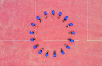 Aerial view, athlete sitting in a circle and doing exercise