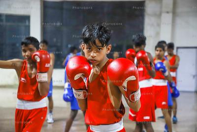 Young small boy in action, punching
