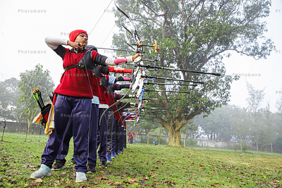 Group of people doing archery practice