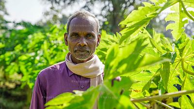 Portrait of a farmer standing in field