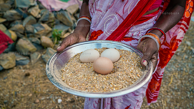 Woman holding Brown egg and white egg in her hand