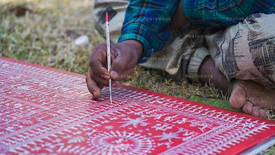 Artist painting odisha painting