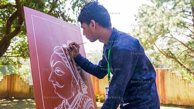 Young artist painting Maharana Pratap portrait