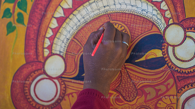 An Artist painting Kathakali.