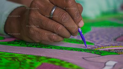 Artist painting madhubani painting close-up