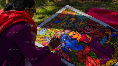 A woman making kolkata painting