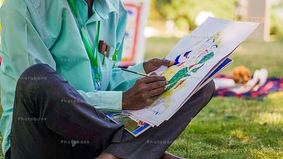 Artist sitting in park and painting