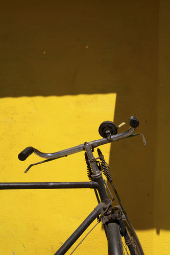 Cycle and a yellow wall