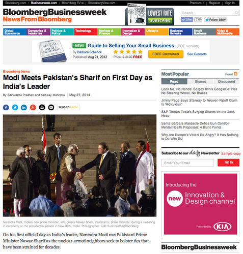 Modi meets Sharif on first day as India's leader