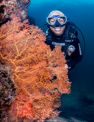 Scuba Diver smiles behind coral at San Rafaelito, La Paz, Baja California Sur, Mexico
