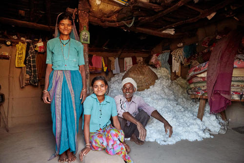The harvested organic cotton is stored in one corner of the small hut in Shiv La, the farmer's, home. The yield per acre is 4-5 quintals and  once collected is taken to the market or the ginning mill. It is 3 years since started organic cultivation and he is really happy with the results.