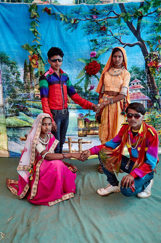 Festivals are an occasion for enjoyment and getting away from the drudgery of daily chores. Women and men dress up in their finest clothes and wear their finest jewellery and get their portraits made in makeshift Photography studios that give them prints while they wait.