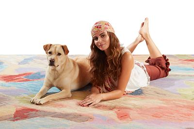 Girl Laying on Rug with Dog