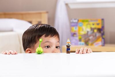 Kid Peeking at Toy