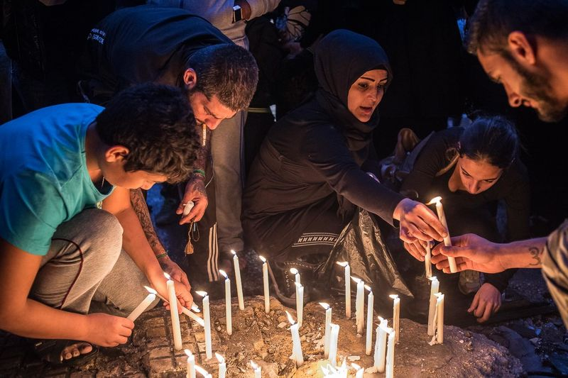 Residents of Beirut's southern district of Bourj al-Barajneh organize a candle vigil for the victims of the twin blasts, Beirut. The explosions left 45 people dead and more than 200 wounded. Schools and universities were shut as people gathered to mourn the victims of the deadly suicide bombings.