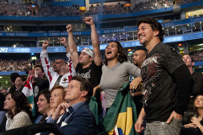 Supporters of the Brazilian fighter Lyoto Machida celebrate his victory against American Randy Couture during UFC 129 in Toronto, April 30, 2011.