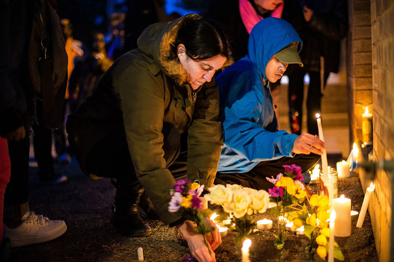 Dozens of Rexdale community members take part in an emotional candle vigil to remember Donald Beckles, in Toronto, April 11, 2015. An area resident, Bekcles was shot and killed outside his home on March 31. The vigil was held at the doorsteps of his home.