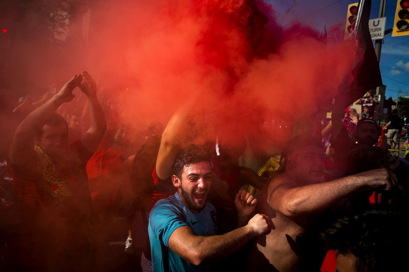 Portuguese soccer fans take over St Clair West Avenue after Portugal's victory over France in the Euro 2016 final match, in Toronto on Sunday, July 10, 2016.