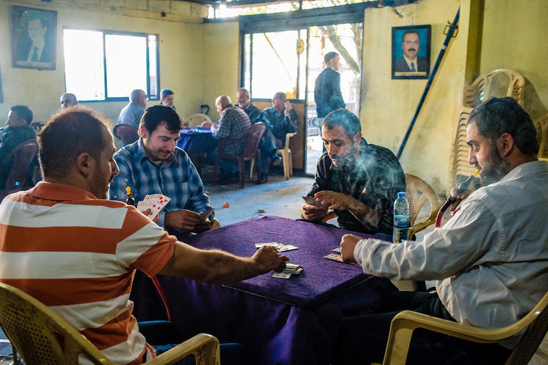 Residents from Jabal Mohsen, a majority-Alawite area, play cards at a local coffee house, Tripoli, Lebanon. Since the start of the civil war in Syria, sectarian tensions between Alawites and Sunnis caused multiple armed clashes between Jabal Mohsen and Bab al-Tabbaneh. The implementation of a security plan has brought the army to the streets and the fighting stopped.