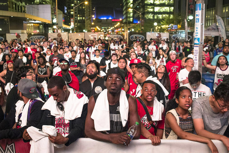 Toronto Raptors' fans watch the action on the big screen outside the Air Canada Centre during game five Eastern Conference final NBA playoff basketball action against the Cleveland Cavaliers in Toronto on Wednesday, May 25, 2016.