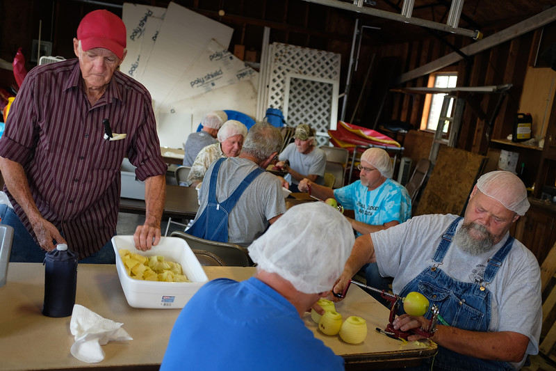 Phil peels apples with members of the Church of the Nazarene, the congregation he attends. Every year for two weeks, they join forces to bake around 5000 thousand apples pies that are sold to raise money for missionary work done by the church. This year Phil peeled about 500 apples every night for two weeks.
