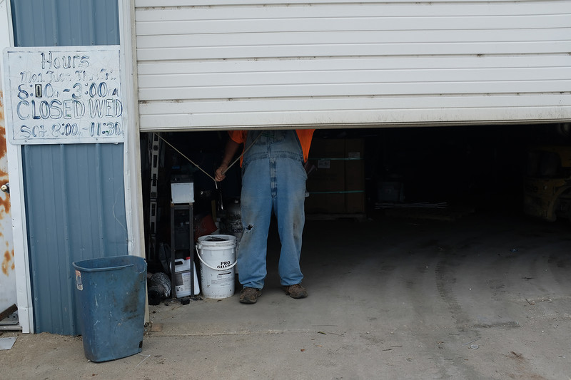 Phil closes down the recycling plant. He always wears overalls, even on his days off.