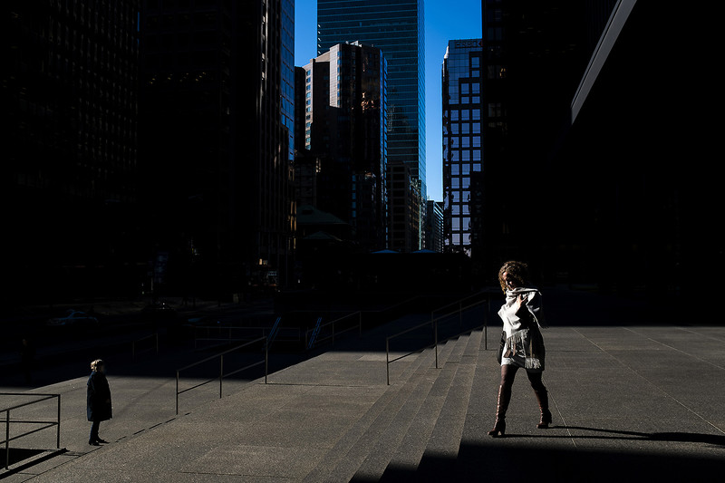 A woman is seen walking outside one of the TD Towers on Wellington St West, in the Toronto financial district, December 5, 2017.