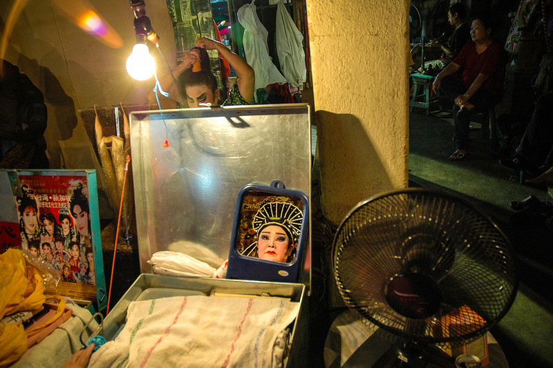 Actors of a Chinese opera make last minute adjustments before going on stage, Kuala Lumpur, October 19, 2007.