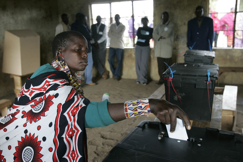 A Masai woman cast her ballot in Bissel some 120 kilometers south west of Nairobi, Thursday, Dec.27, 2007 during the Kenyan Presidential election