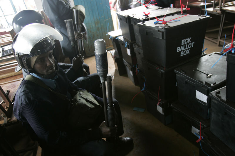Riot police protect ballot boxes after violence broke out over reported election fraud, Friday, Dec. 28, 2007 in Ngong town just outside Nairobi.