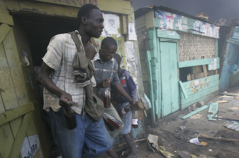 Supporters of the Orange Democratic Party loot petrol from a kiosk, Saturday, Dec. 29, 2007 during riots in the Kibera slum in Nairobi.
