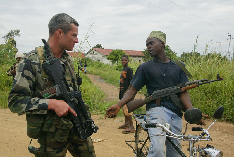 A French soldier and a Hema malitia fighter exchange words, Wednesday, June 11. 2003 on the outskirts of Bunia, Congo.