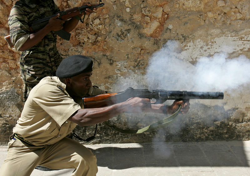 Members of the army and police fire on members of the opposition , Sunday, Oct. 30, 2005 who is trying to prevent people from outside the area from voting in Stone Town in Zanzibar. The people were brought in on trucks by police to vote in an opposition stronghold., Sunday, Oct. 30, 2005 as they prevent them from reaching a polling station in Zanzibars Stone TownTensions were high on the Indian Ocean island of Zanzibar as voters chose Sunday between the socialists who have ruled the semiautonomous state for more than 30 years and an opposition group promising wholesale change.