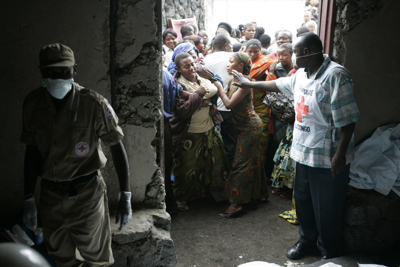 A Congolese woman react after she saw a family member at a morgue, Wednesday, April 16, 2008 after a Congolese jetlainer carshed on takeoff in Goma.