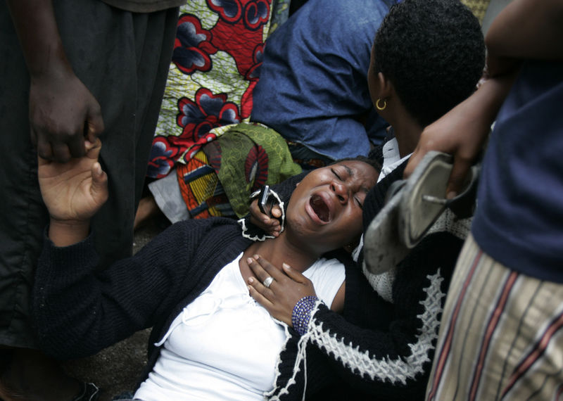 A Congolese woman cry after she saw a family member at a morgue, Wednesday, April 16, 2008 after a Congolese jetlainer carshed on takeoff in Goma.