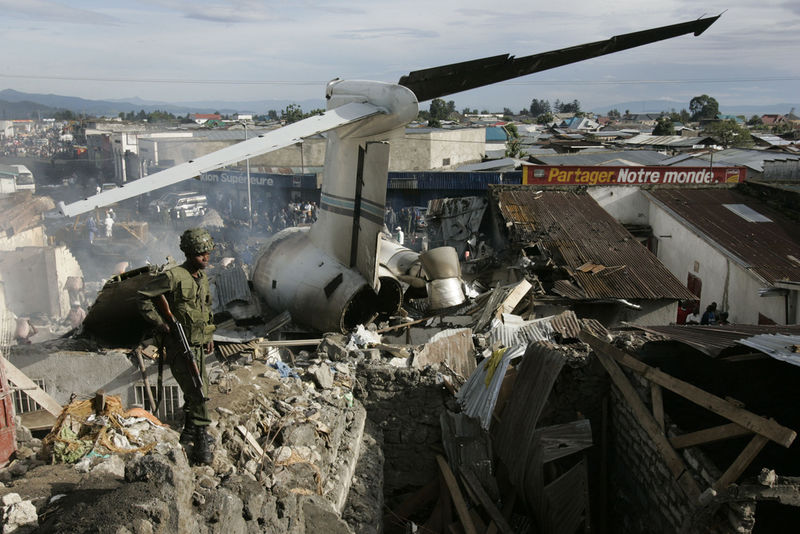 A Congolese soldier walk amongst the wreckage, Wednesday, April 16, 2008 of a Congolese jetlainer that carshed on takeoff in Goma