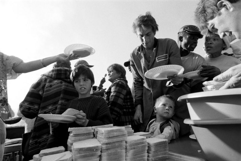 People receive a free lunch given by church, Gauteng 1998