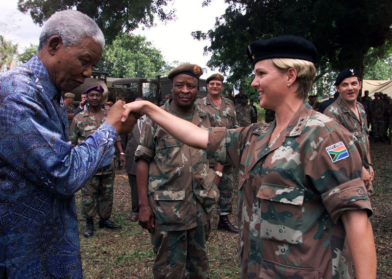 Nelson Mandela greets Capt. Yolanda Roberts of the South African army at their base in Bujumbura,Burundi ,Friday,Nov 1,2001after he attended the inauguaration of the transition goverment